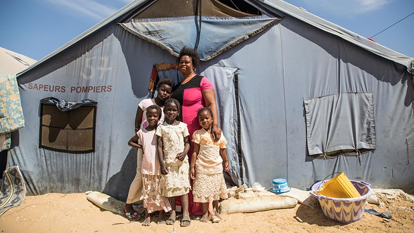 Aminata Dieng and her four children had to leave her house destroyed by rising waters in Saint Louis, Senegal. Now she lives in Camp Khar Yallah for internal displaced people due to climate change. Photo: Vincent Tremeau/World Bank